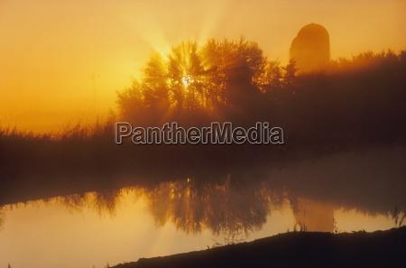 farm silos at sunrise alberta canada