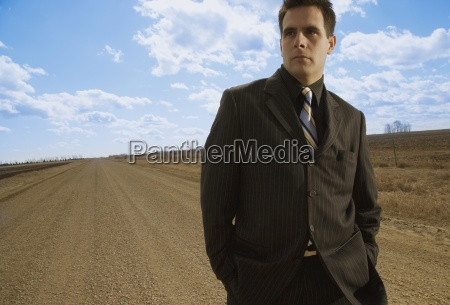 man on gravel road
