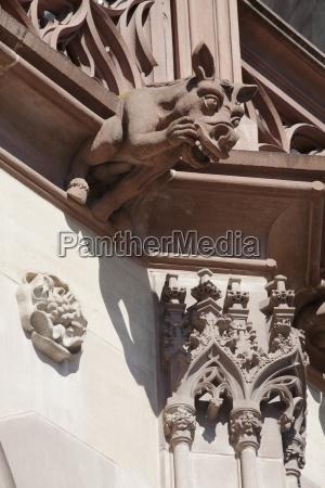 detail of sandstone animal gargoyle in