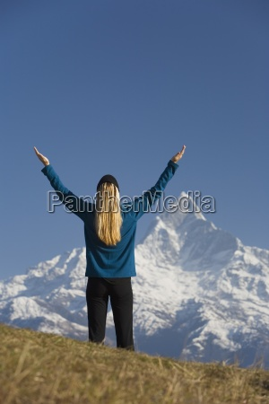 a woman in awe mount machapuchare
