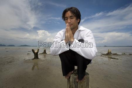 man praying koh lanta thailand asia