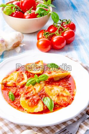 delicious pasta ravioli in tomato