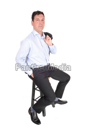 a business man sitting with his