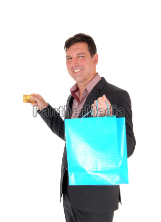 happy man going shopping with credit