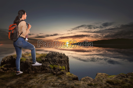 young asian traveler woman standing and