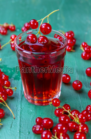 red currant juice in glass with