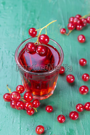 redcurrant and glass of fruit drink