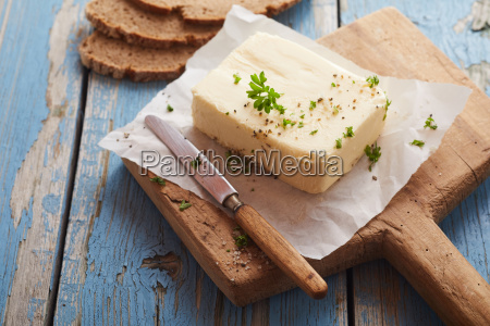 pat of butter seasoned with fresh