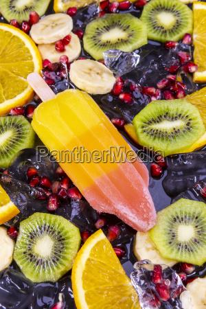 fruit popsicles ice cream on black