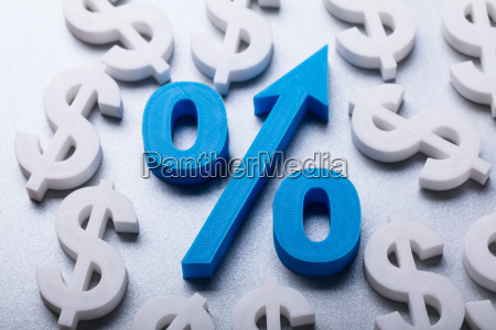 percentage symbol surrounded by many dollar