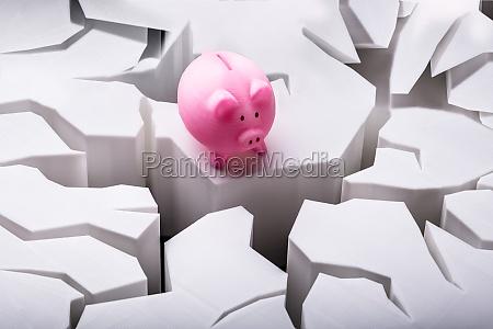 piggybank on cracked white surface