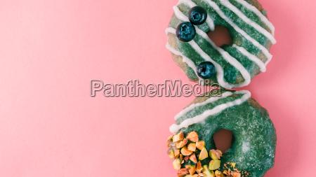 donut topped spirulina glaze on pink