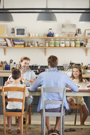 family having lunch together in their