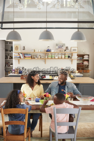 black family of four having lunch