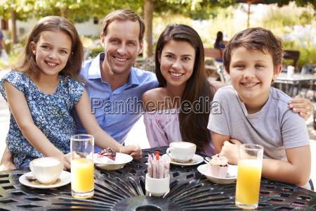 portrait of family enjoying snack at