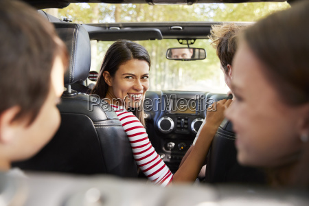 family driving in open top car