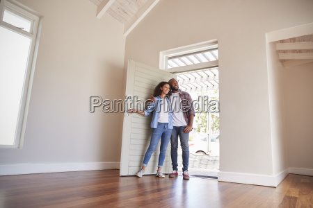 couple opening door and walking in