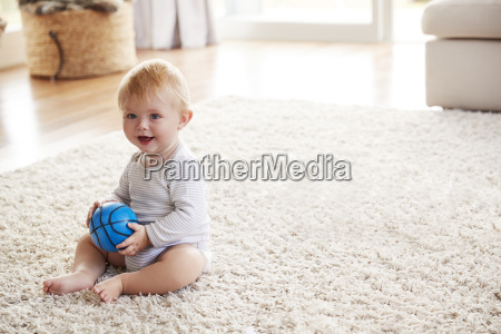white toddler boy sitting on the