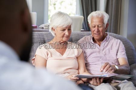 happy senior couple taking financial advice