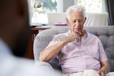 senior man with depression having therapy