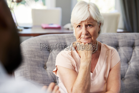 depressed senior woman having therapy with