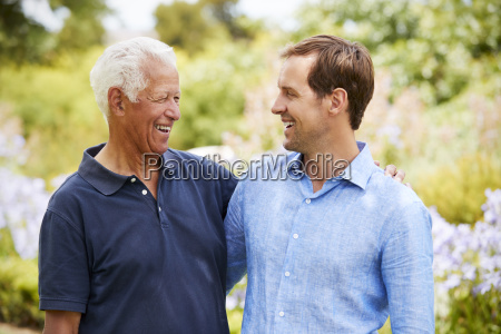 senior father with adult son on