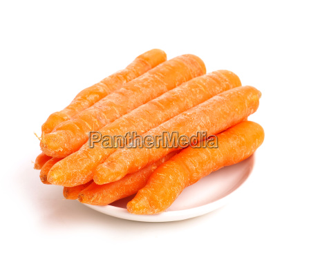 organic baby carrots on a plate