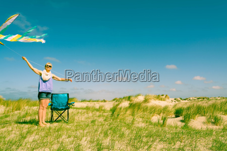 woman on vacation with kite in