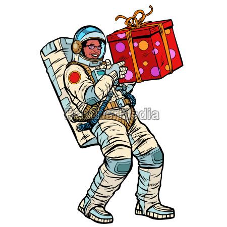 kosmonaut mit geschenkbox afroamerikanischen volk