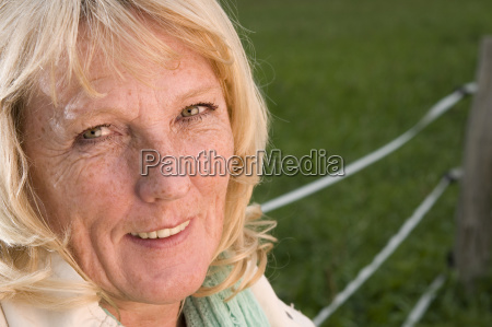 smiling blond mature woman