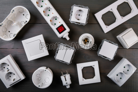 white electrical equipment on wooden background