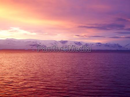 sunrise over brabant island gerlache strait