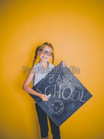 beautiful blond girl with glasses holding