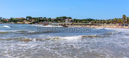 storm beach rocks mediterranean sea bridge