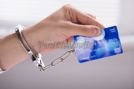 an arrested person hand linked to