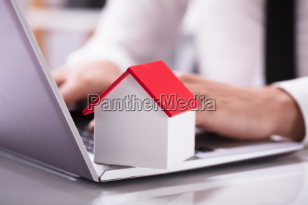 house model with red roof on