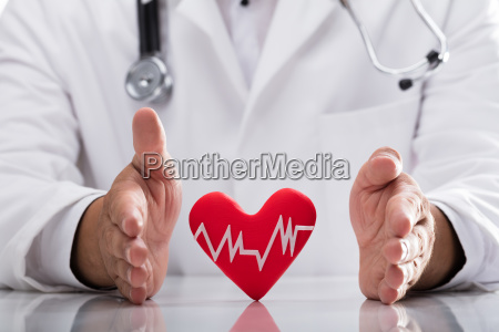 doctor protecting red heart rate