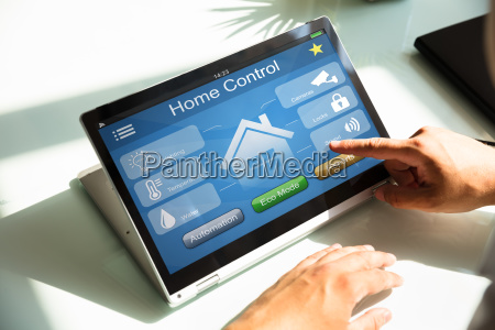 person using home control system on