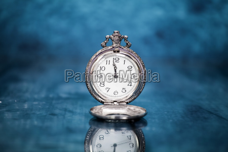 old clock on blue background