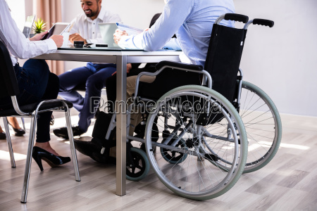 disabled businessman sitting in office