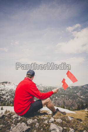 hiker with red sweater is holding