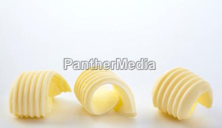 border of three twirled butter curls