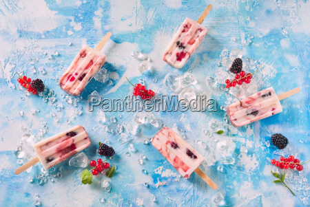 mixed berry yogurt popsicles on chilled