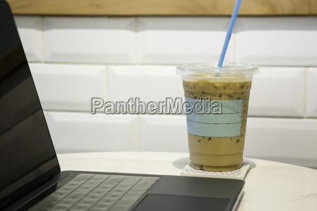 laptop on table in coffee shop