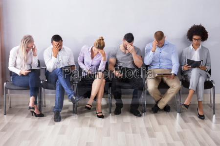 bored people waiting for job interview