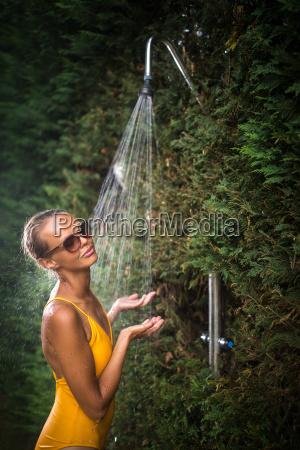 beautiful young woman taking a shower