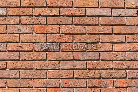 hintergrund aus einer gleichmaessig roten backsteinmauer