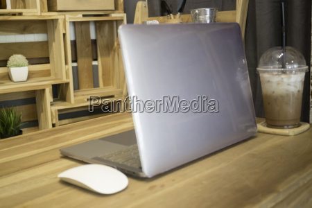 comfortable work desk with notebook laptop