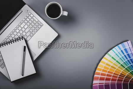 designer workplace with color palette and