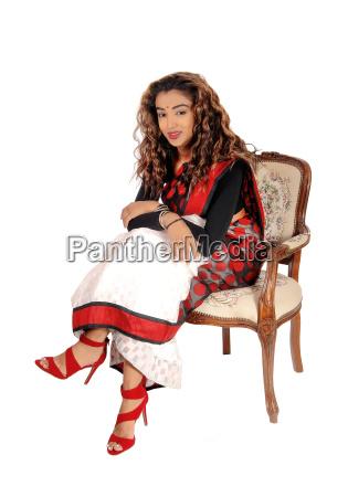 beautiful east indian woman sitting in